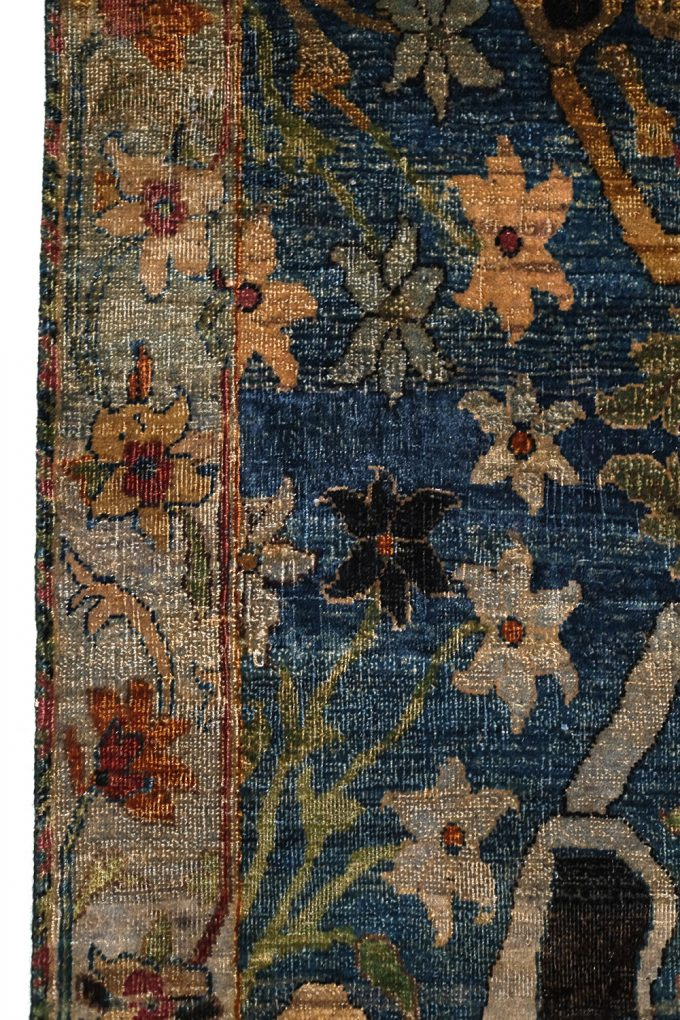 floral colored accents on a blue background rug