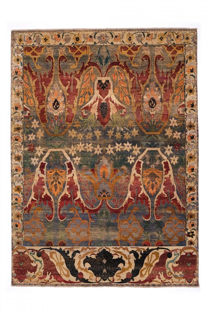 intricate beautiful autumnal colored rug