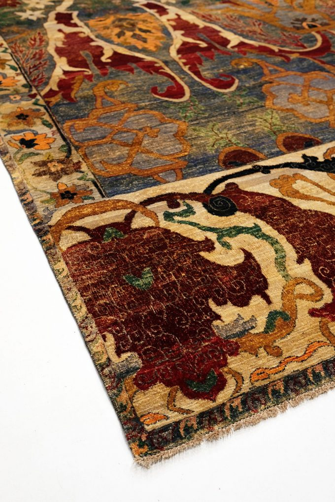 corner of the floral rust and gold rug